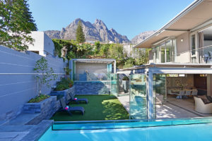 Camps Bay Villa : 4 Views of house summer house & bar from beyond pool
